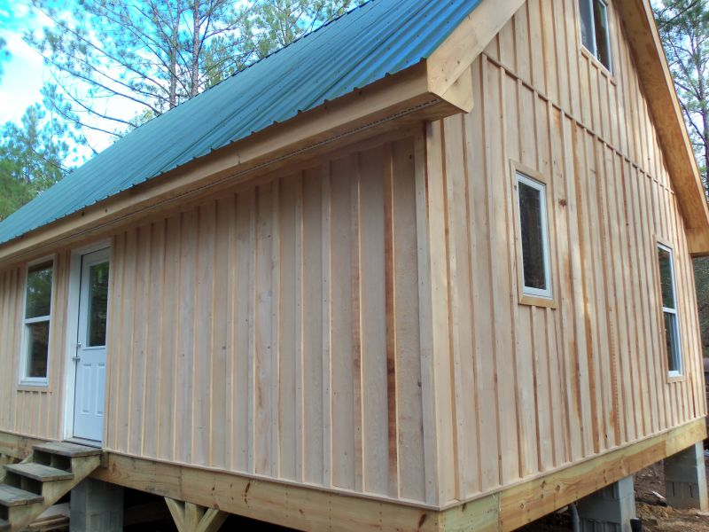 Siding Option Ideas further Small Wonder A Timber Home Built For Two likewise House Plans Built Into Side Hill additionally The Rustic Beauty Of Barn House Plans also Weathered Wood Wall. on barn board and batten wood siding
