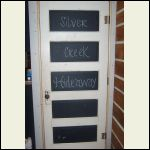 doorway under the stairs-I used blackboard paint for middles...Silver Creek Hideaway is what we call