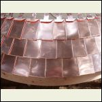 handmade copper shingles on staircase turret roof