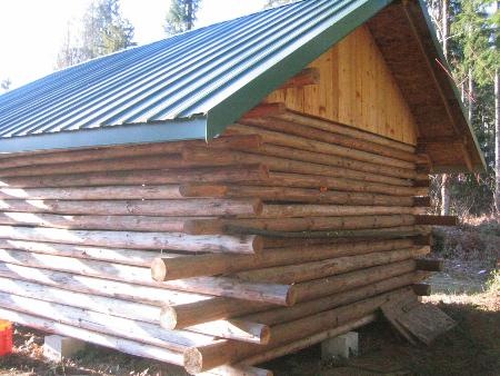 Our log home in russia 75 done small cabin forum for How to build a butt and pass log cabin