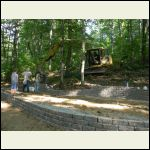 Retaining wall with inspector