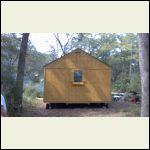 cabin on wheels being delivered