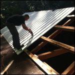 Me installing roof panels