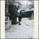 Gary O keeping snow off the tarport