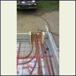 The manifold (2 out / 2 in) + Temp Sensor line to slab centre.