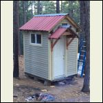 Little shower house in the woods.