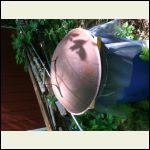Covered outside 55 gal barrel