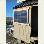 Solar panel mounted on South-facing exterior wall.
