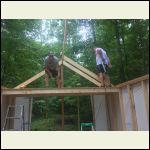 ridge board and first sets of rafters are up